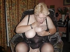 Big Tittied Granny Manages To Lick Her Own Tits