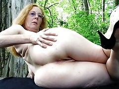 Amateur granny posing nude in forest