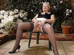 Horny blonde mature slut posing in black lingeries