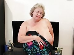 Horny busty  mature slut taking off clothes