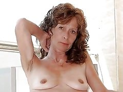 Dirty mature slut posing naked