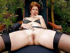 Granny spread legs outdoor to show her old cunt