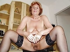 Classy grandma with saggy tits wears black stocking