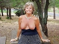 A mature granny flashes her boobs in the park