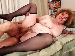 Horny old bitch getting a hard cock in her hairy pussy