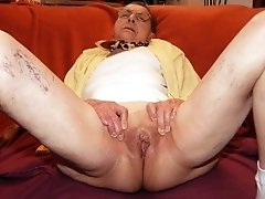 Granny Diana shows all her lingerie & pussy
