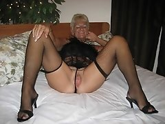 Grandma in black stockings spreads her old cunt