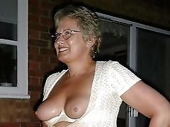 a very sexy blonde granny with glasses