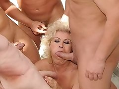Sultry granny sucks a meaty young cock greedily