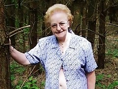 Granny flashing in the wood hoping to find some unknown cock