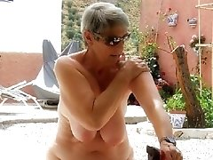 Hot granny Alicia exposing off her massive set of saggy knockers