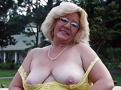 Mature blonde big tits housewife from Tirolo flashing