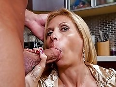 This blonde mature slut sucks cock