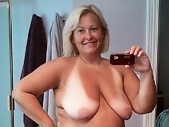 Tanned granny Tessa exposes her white boobs