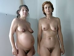 Two hot older women getting naked and showing off their aged pussies