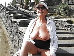 Mature Eendy shows off her big tits for the camera