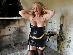 Blonde mature wife poses in black stockings