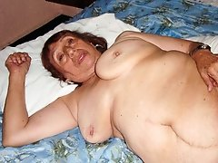 Mature masturbates and shows her big pussy